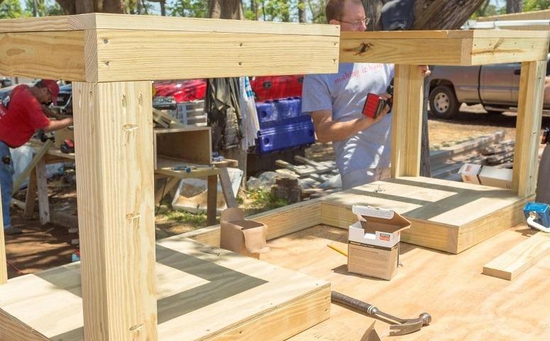 Man Assembling Pallet BBQ Stand