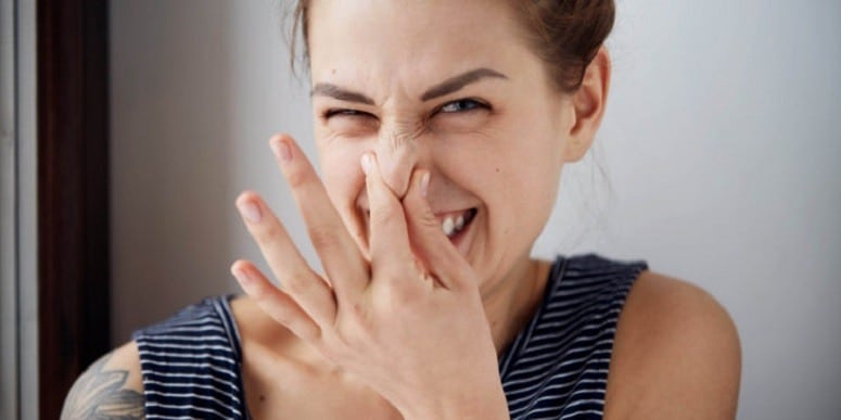 Woman Holding Fingers On Nose