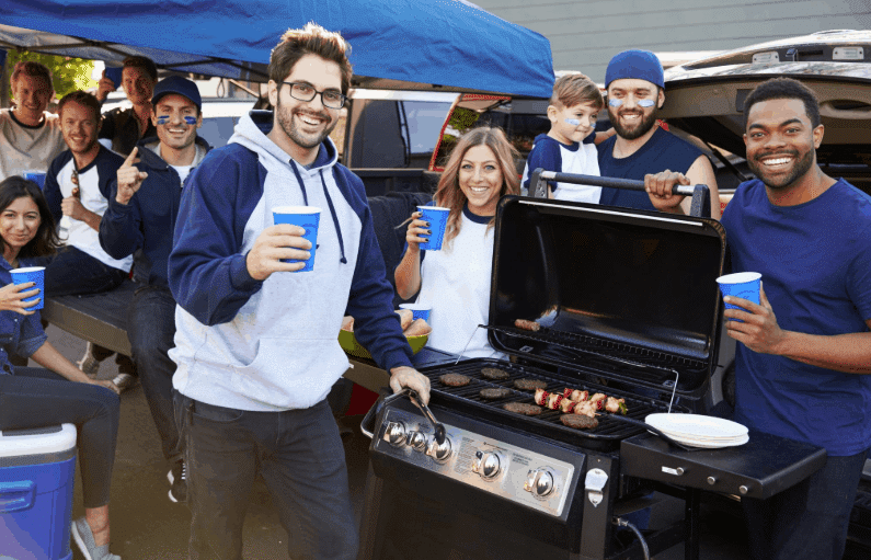 Dad tailgating at football game with BBQ
