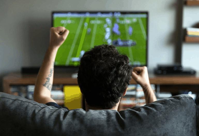 Dad watching football