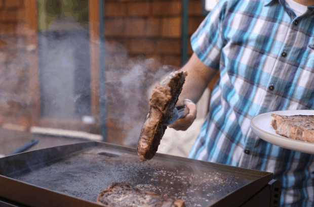 Man Grilling a Steak