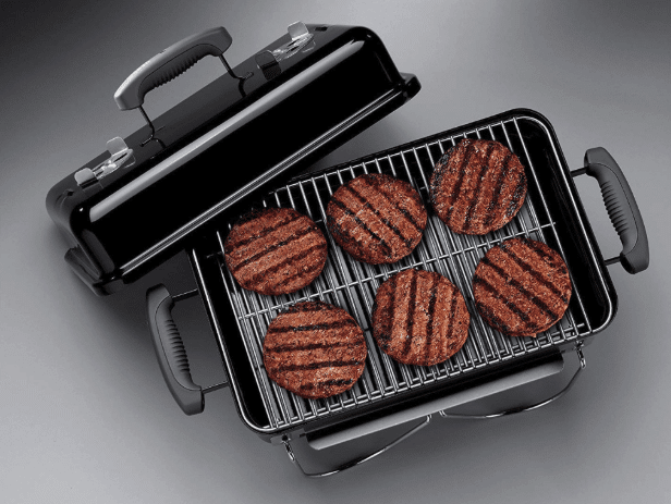 Grill with six hamburgers on it