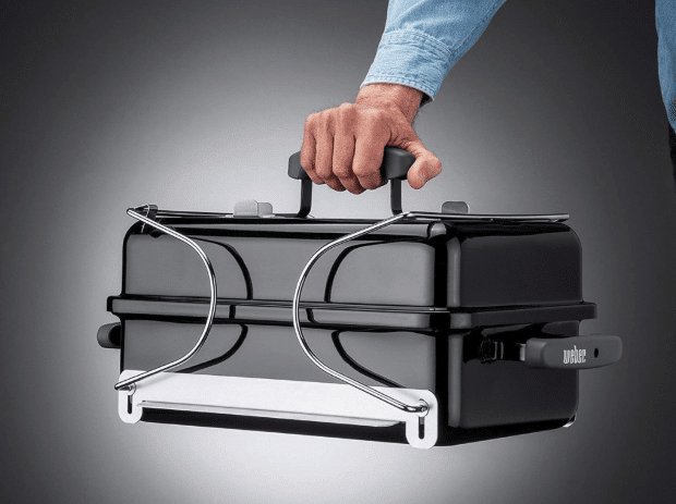 Man holding a closed portable grill