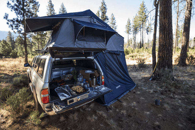 Camping truck with trunk open and grill on top