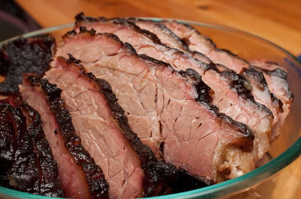 glass bowl with slices of smoked brisket