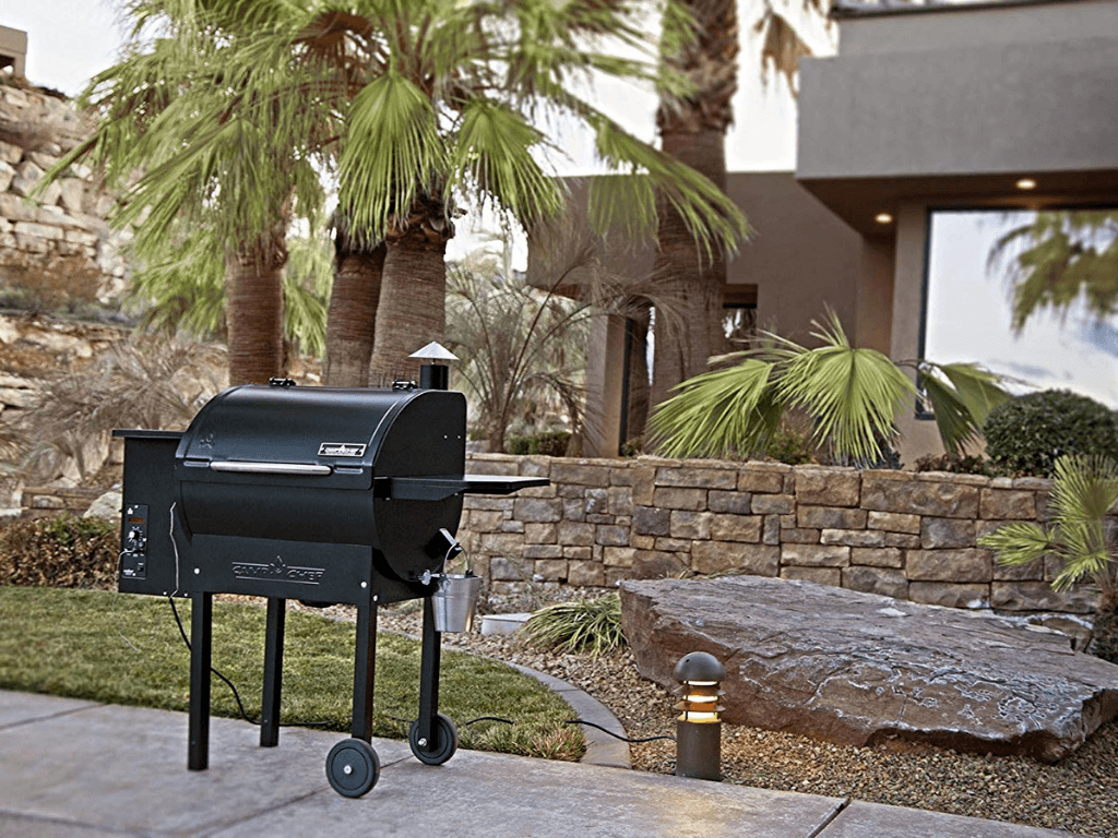 Camp Chef Pro Pellet Grill outside in backyard with palm trees