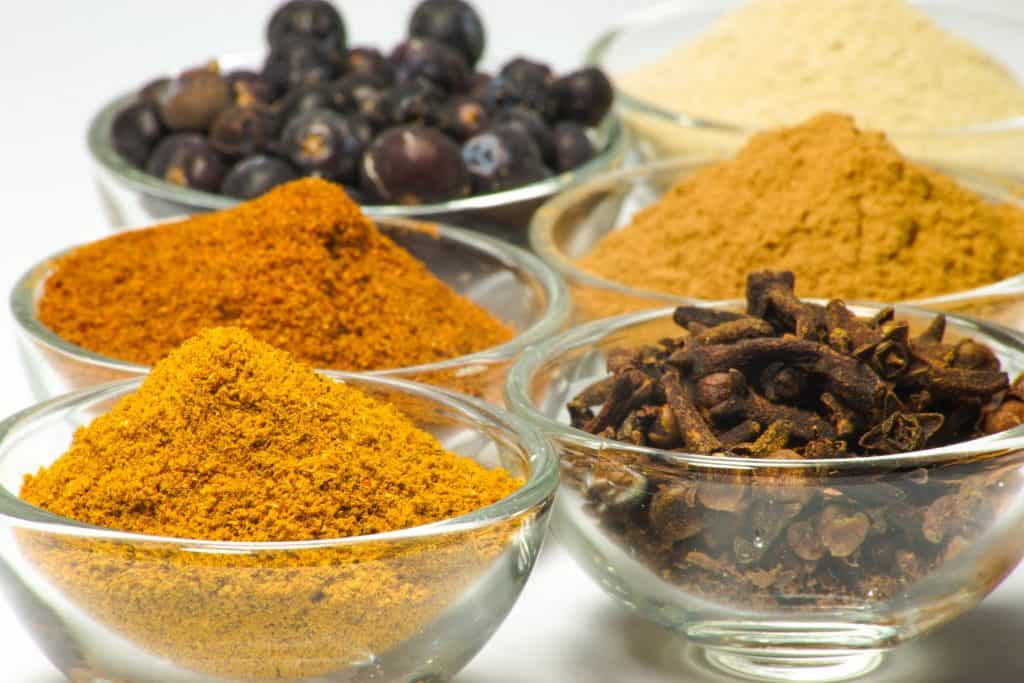 paprika and other spices in small glass bowls for smoked meat