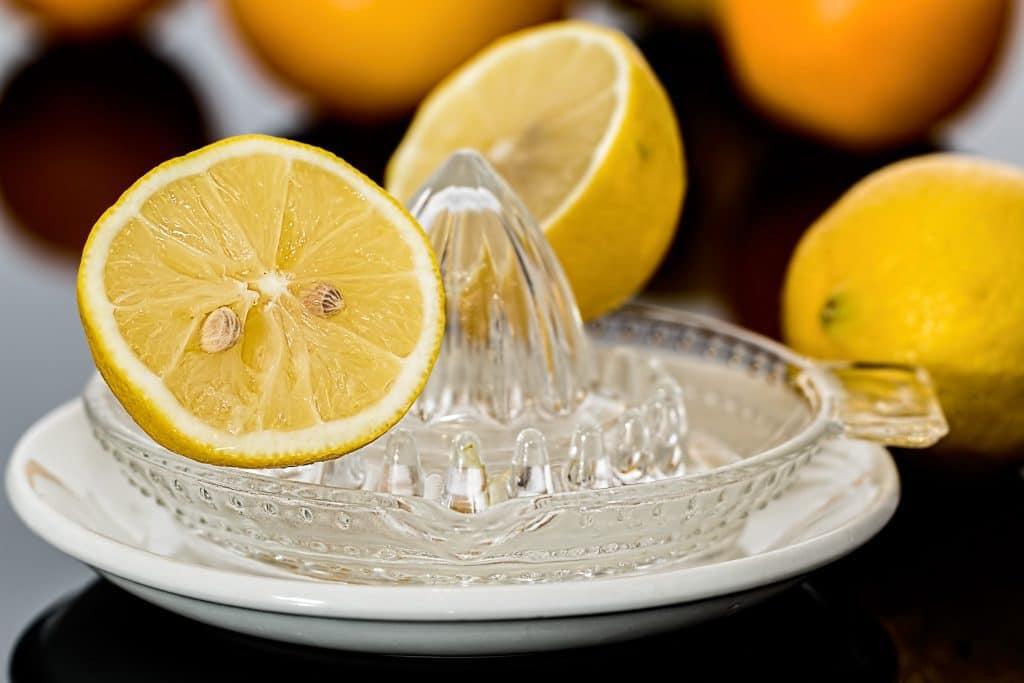 lemon cut in half on a lemon juicer