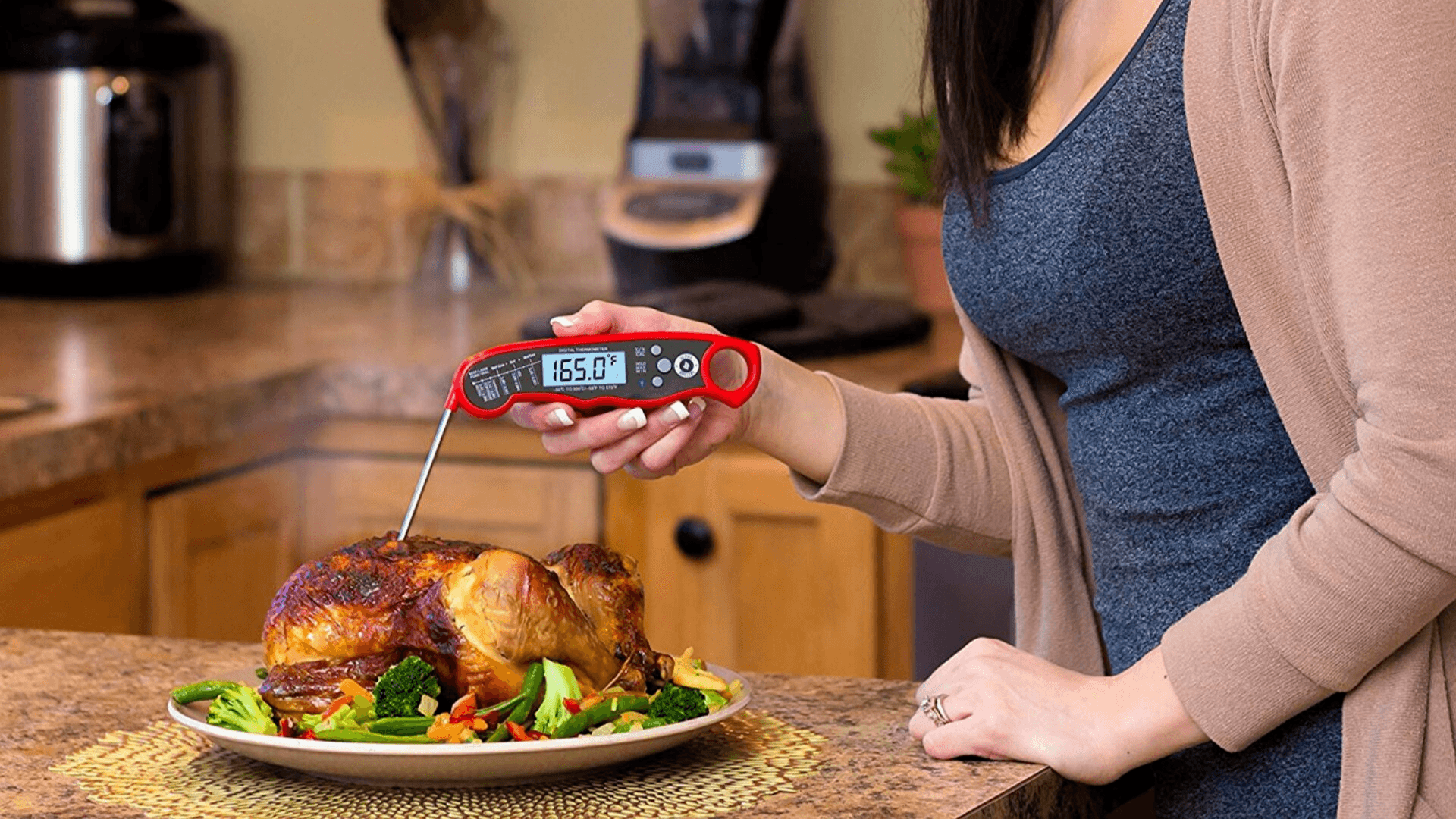 picture of woman using a meat thermometer for chicken on a serving plate