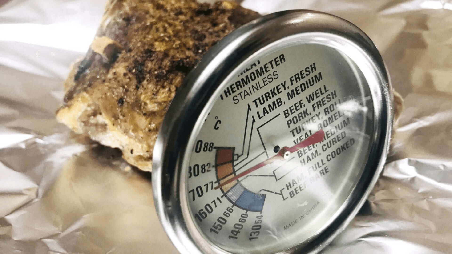 Blacksail Kitchen Analog Meat Thermometer being used for cooking meat
