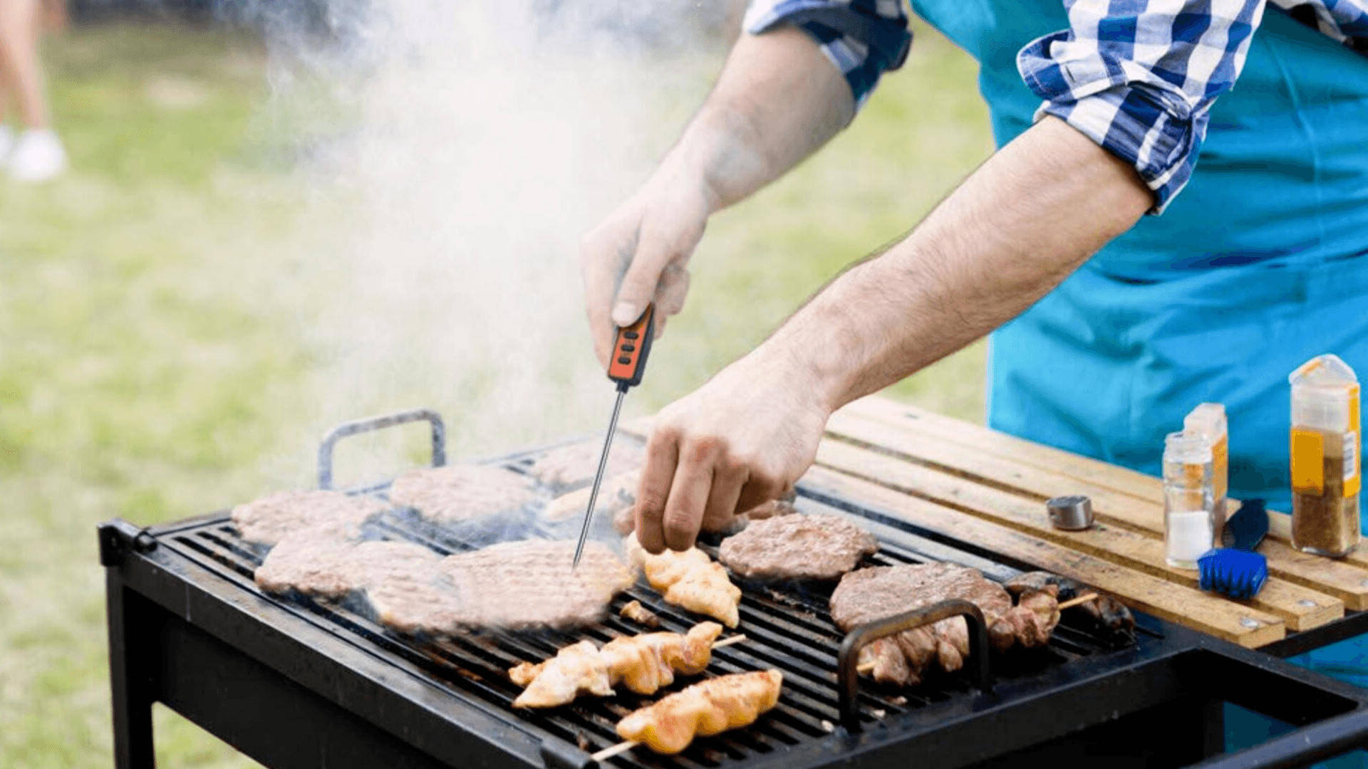 Picture of man using best meat thermometer for meat on bbq