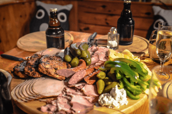 A spread of smoked meats and cheeses