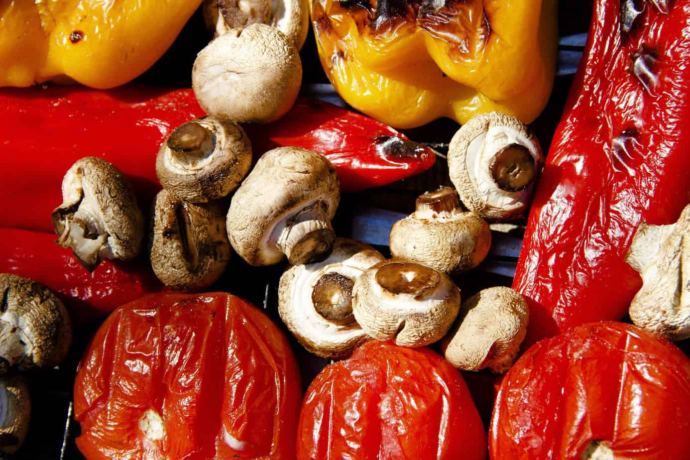 picture of peppers and mushrooms on grill