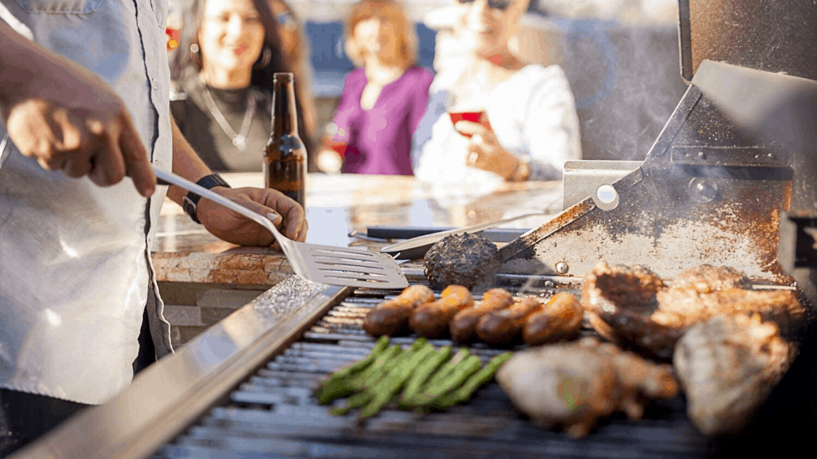 image of man using spatula to turn meat and veggies on grill