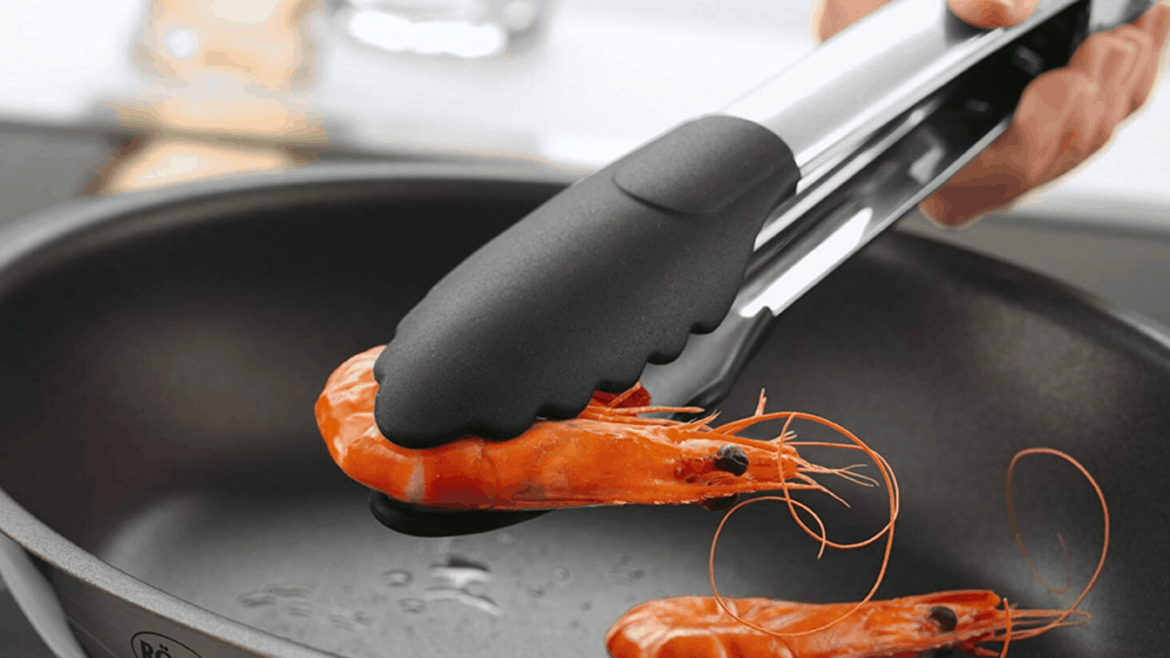 """Image of Rösle Stainless Steel Silicon Coated Locking Tongs, 9"""" inch picking up shrimp"""