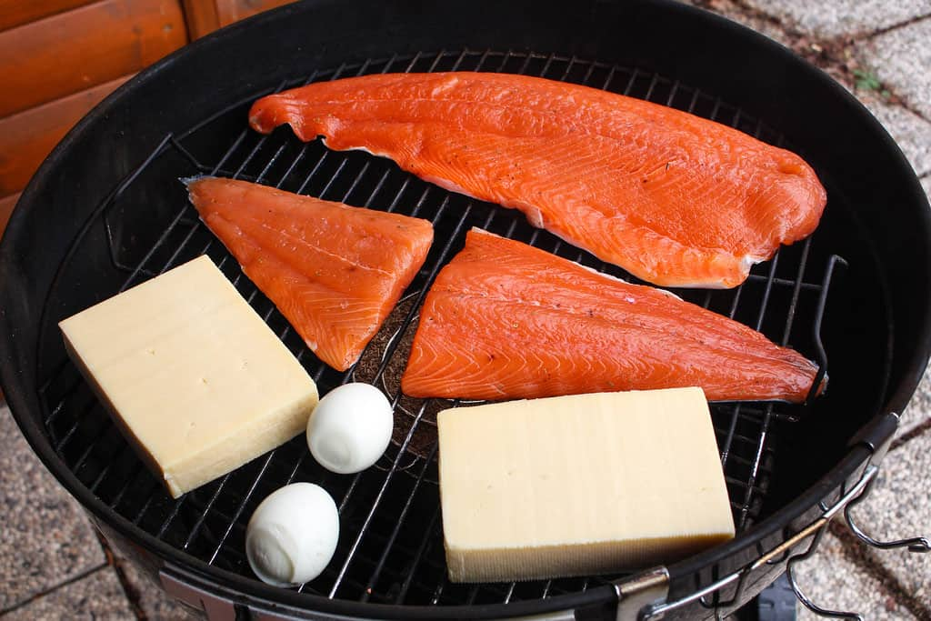 Image of Salmon, Cheese, and Eggs on a smoker