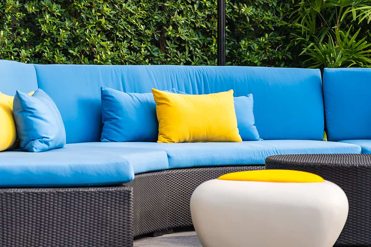 Outdoor patio in the garden with sofa chair and pillow decoration